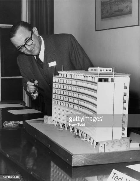 Sir Joshua Hassan the Chief Minister of Gibraltar inspects a model of a motor hotel in London 24th November 1964 The hotel will be built in the UK by...