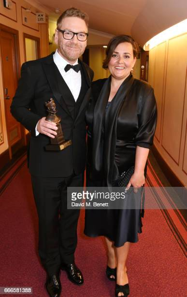 Sir Kenneth Branagh winner of the Special Award and Lindsay Brunnock pose in the winners room at The Olivier Awards 2017 at Royal Albert Hall on...