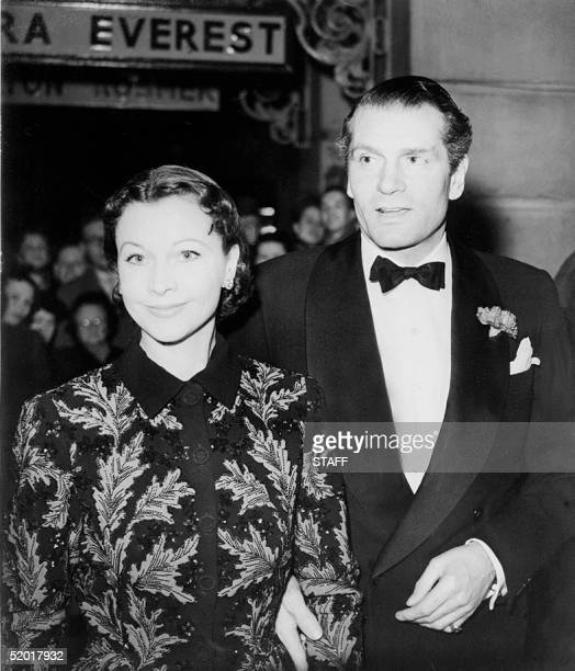 Sir Laurence Olivier and his actress wife Vivien Leigh arrive at the New Theatre 14 February 1951 to attend the London first night of Bernard Shaw's...