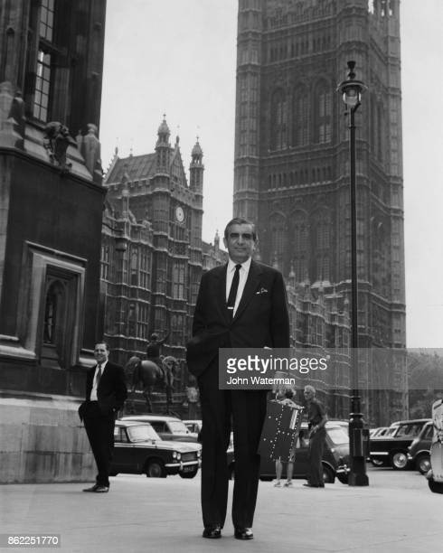Sir Leon Bagrit chairman of ElliottAutomation Ltd arrives at the House of Commons in London carrying one of his company's 920M miniature computer...