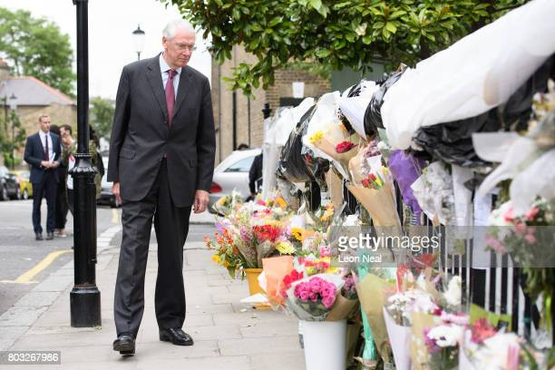 Sir Martin MooreBick looks at floral tributes as he leaves the Parish of St Clement church after meeting local residents on June 29 2017 in London...