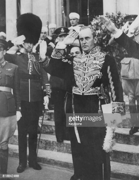 Sir Maurice Peterson the British Ambassador to Nationalist Spain salutes to the National Anthem as he leaves General Franco's residence in Burgos...