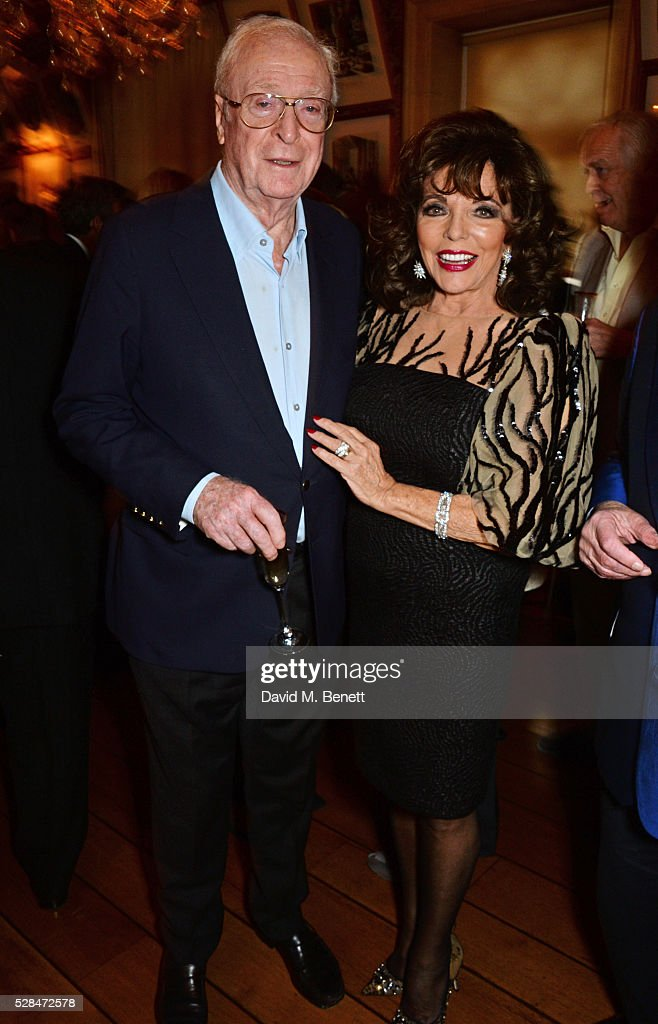 Sir Michael Caine (L) and Dame Joan Collins attend the launch of Dame Joan Collins' new book 'The St. Tropez Lonely Hearts Club' at Harry's Bar on May 5, 2016 in London, England.