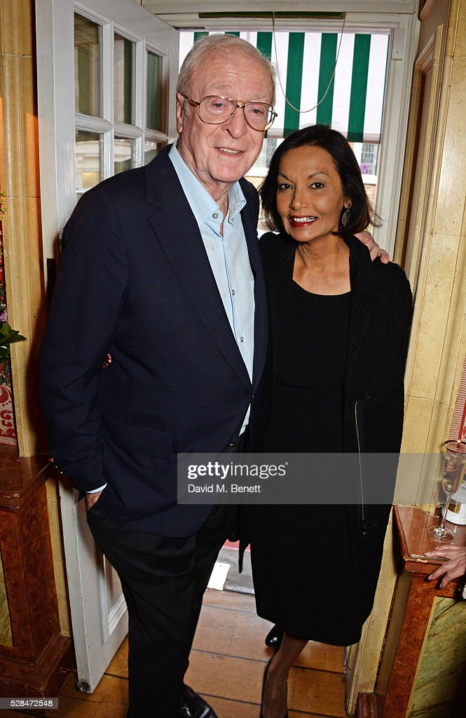 Sir Michael Caine (L) and Shakira Caine attend the launch of Dame Joan Collins' new book 'The St. Tropez Lonely Hearts Club' at Harry's Bar on May 5, 2016 in London, England.