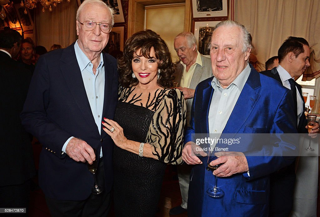 Sir Michael Caine, Dame Joan Collins and Frederick Forsyth attend the launch of Dame Joan Collins' new book 'The St. Tropez Lonely Hearts Club' at Harry's Bar on May 5, 2016 in London, England.