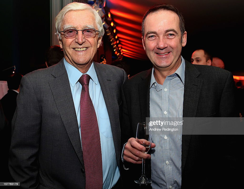 Sir <a gi-track='captionPersonalityLinkClicked' href=/galleries/search?phrase=Michael+Parkinson&family=editorial&specificpeople=159753 ng-click='$event.stopPropagation()'>Michael Parkinson</a> (left) and Andy Duncan, MD of Camelot, pose for a photograph during the SJA 2012 British Sports Awards at The Pavilion at the Tower of London on December 6, 2012 in London, England.