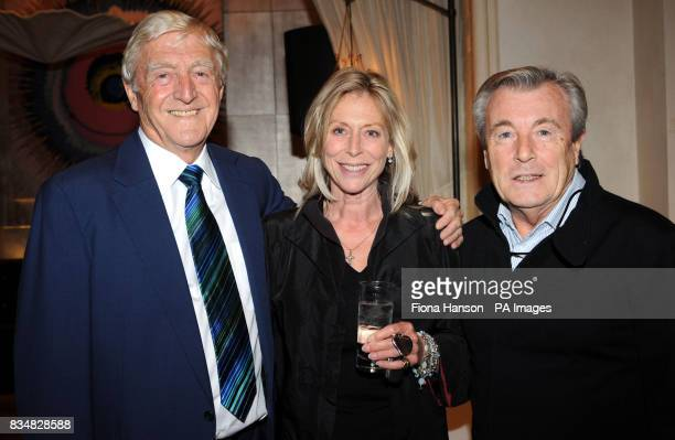 Sir Michael Parkinson with photographer Terry O'Neill and his wife Larraine at a party to celebrate the publication of his memoir 'My Autobiography'...