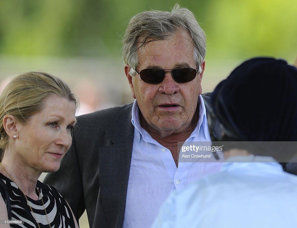 Sir Michael Stoute chats with Ryan Moore at Leicester racecourse on July 18, 2013 in Leicester, England.