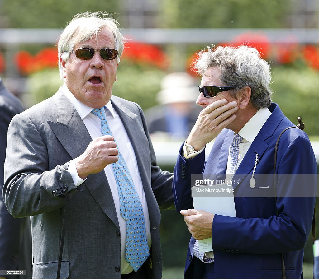 Sir Michael Stoute (trainer of Queen Elizabeth II's horse Estimate) seen in conversation with John Warren (Queen Elizabeth II's Racing Manager) as they attend the King George Day Meet at Ascot Racecourse on July 26, 2014 in Ascot, England.