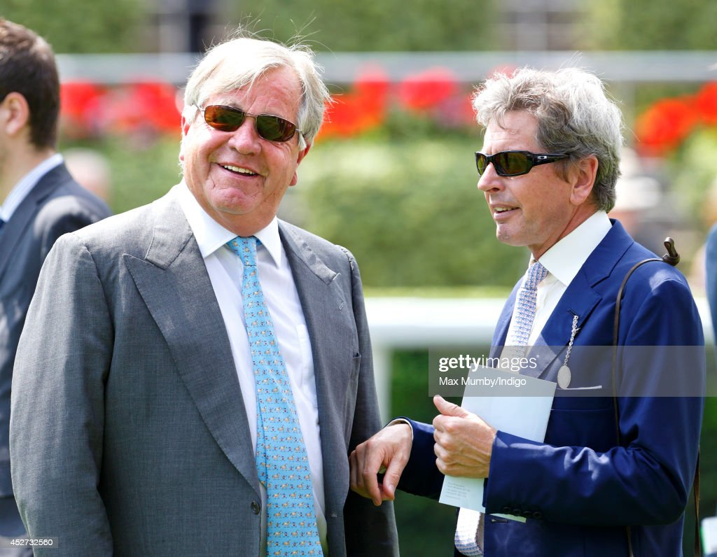 Sir Michael Stoute (trainer of Queen Elizabeth II's horse Estimate) seen in conversation with <a gi-track='captionPersonalityLinkClicked' href=/galleries/search?phrase=John+Warren+-+Racing+Advisor&family=editorial&specificpeople=14677107 ng-click='$event.stopPropagation()'>John Warren</a> (Queen Elizabeth II's Racing Manager) as they attend the King George Day Meet at Ascot Racecourse on July 26, 2014 in Ascot, England.