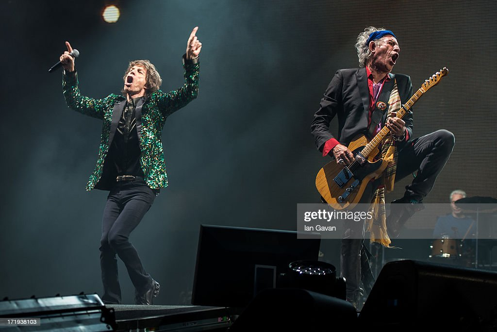 Sir Mick Jagger and Keith Richards of The Rolling Stones perform on the Pyramid Stage during day 3 of the 2013 Glastonbury Festival at Worthy Farm on June 29, 2013 in Glastonbury, England.
