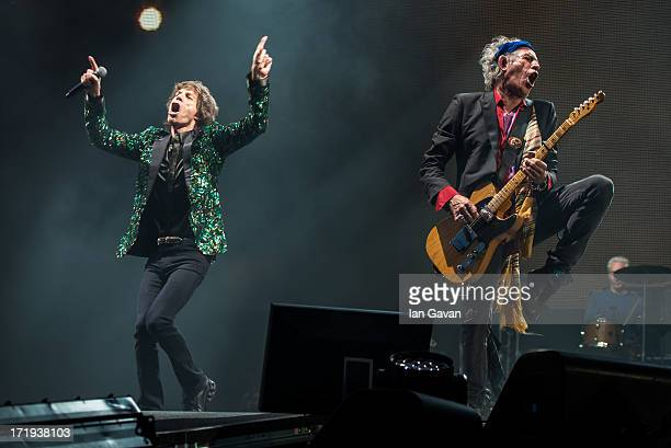 Sir Mick Jagger and Keith Richards of The Rolling Stones perform on the Pyramid Stage during day 3 of the 2013 Glastonbury Festival at Worthy Farm on...