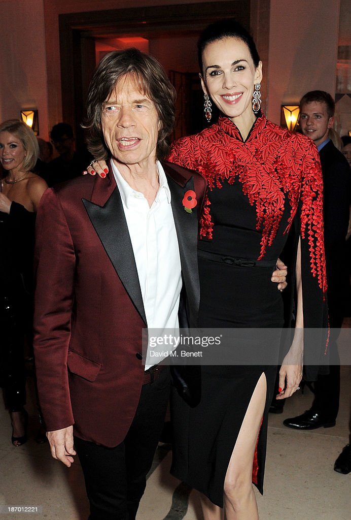 Sir Mick Jagger (L) and L'Wren Scott arrive at the Harper's Bazaar Women of the Year awards at Claridge's Hotel on November 5, 2013 in London, England.