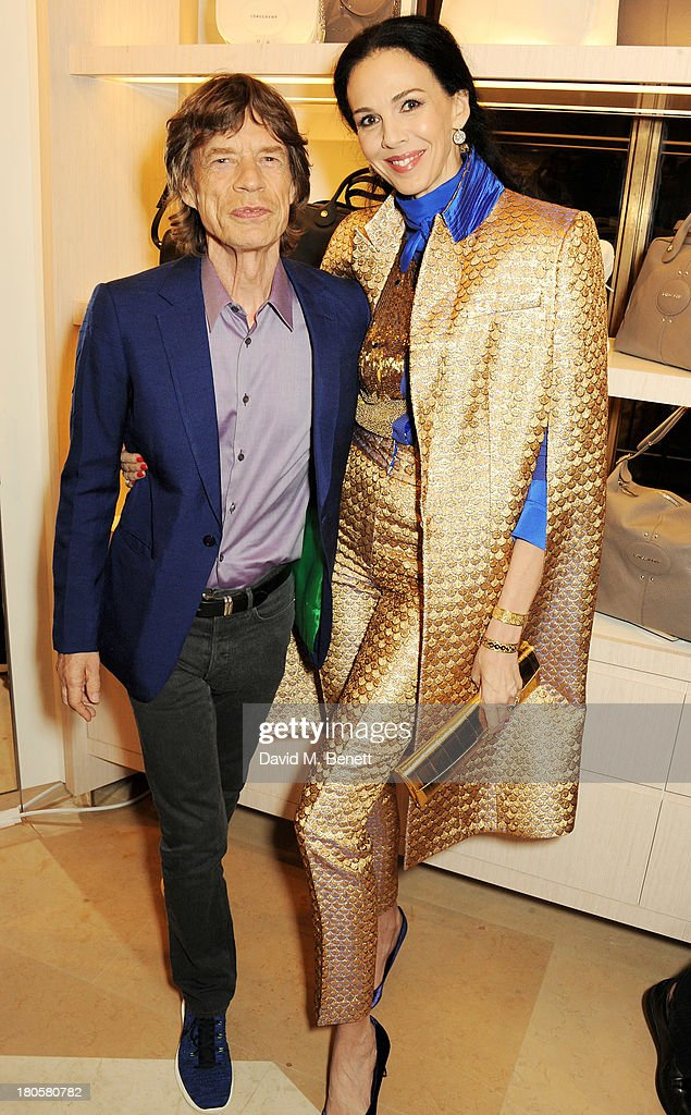 Sir Mick Jagger (L) and L'Wren Scott attend the launch of the Longchamp London flagship store on September 14, 2013 in London, England.