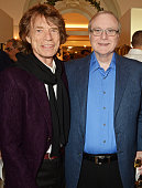 Sir Mick Jagger and Paul Allen attend The 8th Annual Filmmakers Dinner hosted by Charles Finch and JaegerLeCoultre at Hotel du CapEden Roc on May 13...