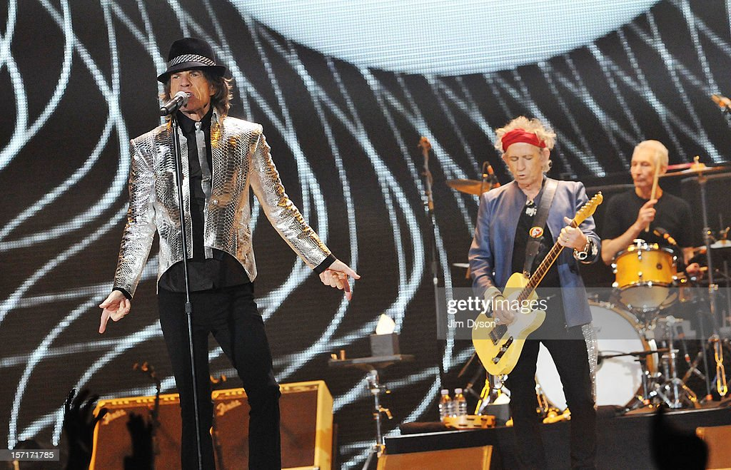 Sir Mick Jagger, Keith Richards and Charlie Watts of The Rolling Stones perform live on stage, during their 50th anniversary tour at O2 Arena on November 29, 2012 in London, England.