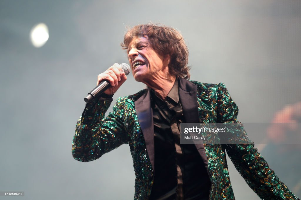 Sir <a gi-track='captionPersonalityLinkClicked' href=/galleries/search?phrase=Mick+Jagger&family=editorial&specificpeople=201786 ng-click='$event.stopPropagation()'>Mick Jagger</a> of The Rolling Stones performs on the Pyramid Stage at Glastonbury Festival 2013 on June 29, 2013 in Glastonbury, England.