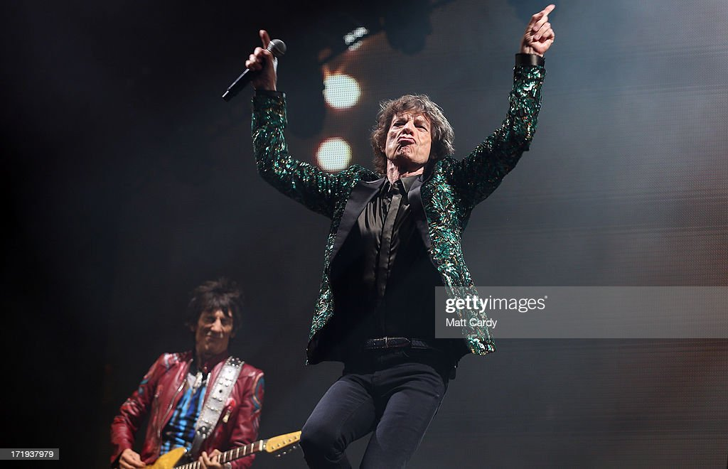 Sir <a gi-track='captionPersonalityLinkClicked' href=/galleries/search?phrase=Mick+Jagger&family=editorial&specificpeople=201786 ng-click='$event.stopPropagation()'>Mick Jagger</a> of The Rolling Stones performs on the Pyramid Stage at Glastonbury Festival 2013 on June 29, 2013 in Glastonbury, England. at the Glastonbury Festival of Contemporary Performing Arts site at Worthy Farm, Pilton on June 29, 2013 near Glastonbury, England. The wholesale market caters for traders throughout the Festival who are estimated to provide 3 million meals for festival-goers, crew and performers. Gates opened on Wednesday at the Somerset diary farm that will be playing host to one of the largest music festivals in the world and this year features headline acts Artic Monkeys, Mumford and Sons and the Rolling Stones. Tickets to the event which is now in its 43rd year sold out in minutes and that was before any of the headline acts had been confirmed. The festival, which started in 1970 when several hundred hippies paid 1 GBP to watch Marc Bolan, now attracts more than 175,000 people over five days.