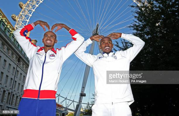 Sir Mo Farah does the Mobot alongside his wax figure from Madame Tussauds London at the foot of the CocaCola London Eye as he bids a final farewell...