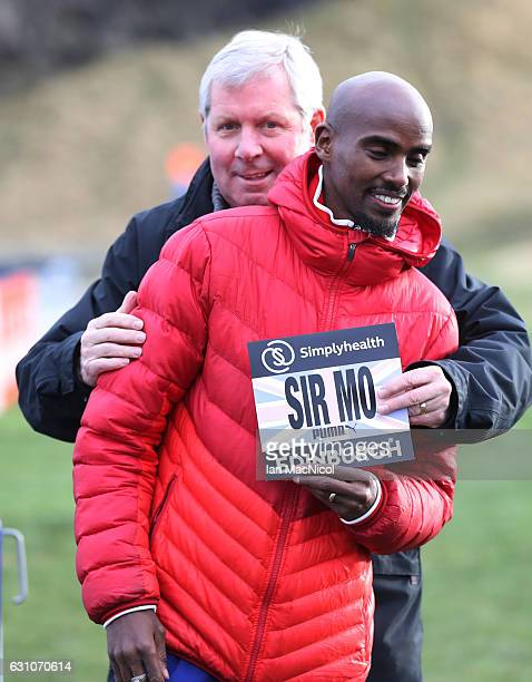 Sir Mo Farah poses for photographs with Bredan Foster in Holyrood Park prior to tomorrow's Great Edinburgh X Country on January 6 2017 in Edinburgh...