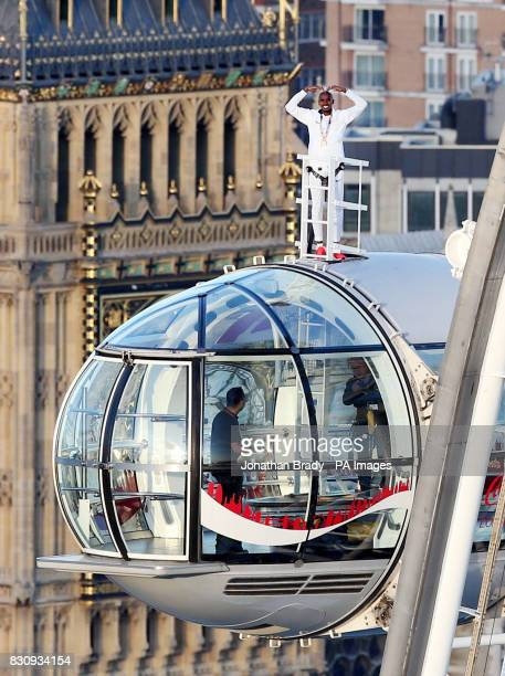 Sir Mo Farah stands at the top of the CocaCola London Eye as he bids a final farewell to British track athletics after winning gold in the 10000m and...