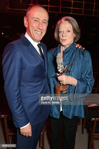 Sir Nicholas Hytner and Dame Maggie Smith attend the London Evening Standard British Film Awards at Television Centre on February 7 2016 in London...
