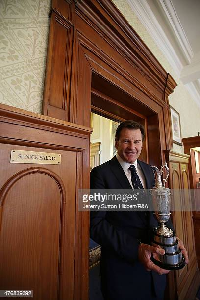 Sir Nick Faldo golfer and three times winner of the Open Championship with his Open Championship winner's Claret Jug stands beside his locker in the...