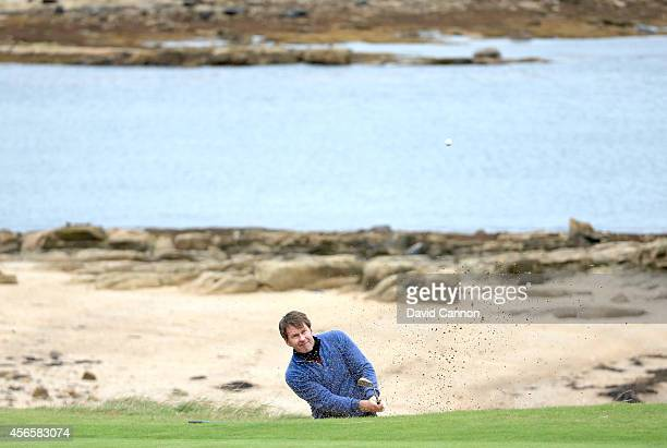 Sir Nick Faldo of England plays his fourth shot on the 12th hole during the second round of the 2014 Alfred Dunhill Links Championship at Kingsbarns...