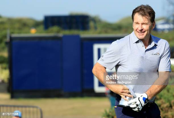 Sir Nick Faldo of England pretends to steal the Claret Jug during a practice round prior to the 146th Open Championship at Royal Birkdale on July 18...