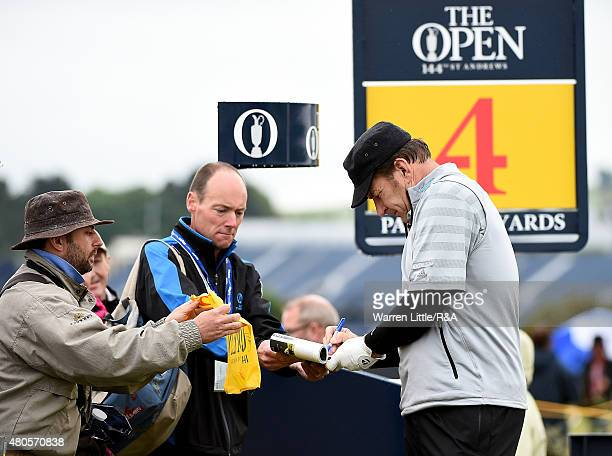 Sir Nick Faldo of England signing autographs for spectators during practice ahead of the 144th Open Championship at The Old Course on July 13 2015 in...