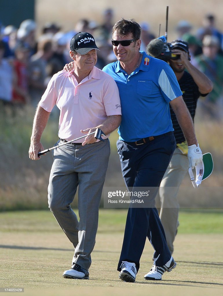 Sir Nick Faldo of England (r) walks down the 18th hole with Tom Watson of the United States during the second round of the 142nd Open Championship at Muirfield on July 19, 2013 in Gullane, Scotland.
