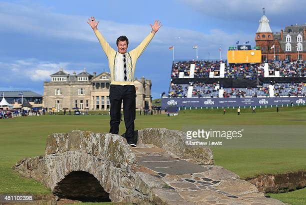 Sir Nick Faldo of England waves to the crowd as he stands on Swilcan Bridge during the second round of the 144th Open Championship at The Old Course...