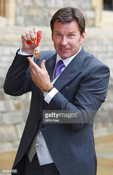 Sir Nick Faldo poses with his knighthood after receiving it from Queen Elizabeth II at Windsor Castle on Novembert 10 2009 in Windsor England The...