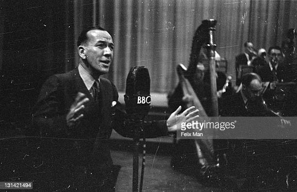Sir Noel Pierce Coward English playwright actor producer and composer singing on the forces radio wavelength 7th August 1943 Original Publication...