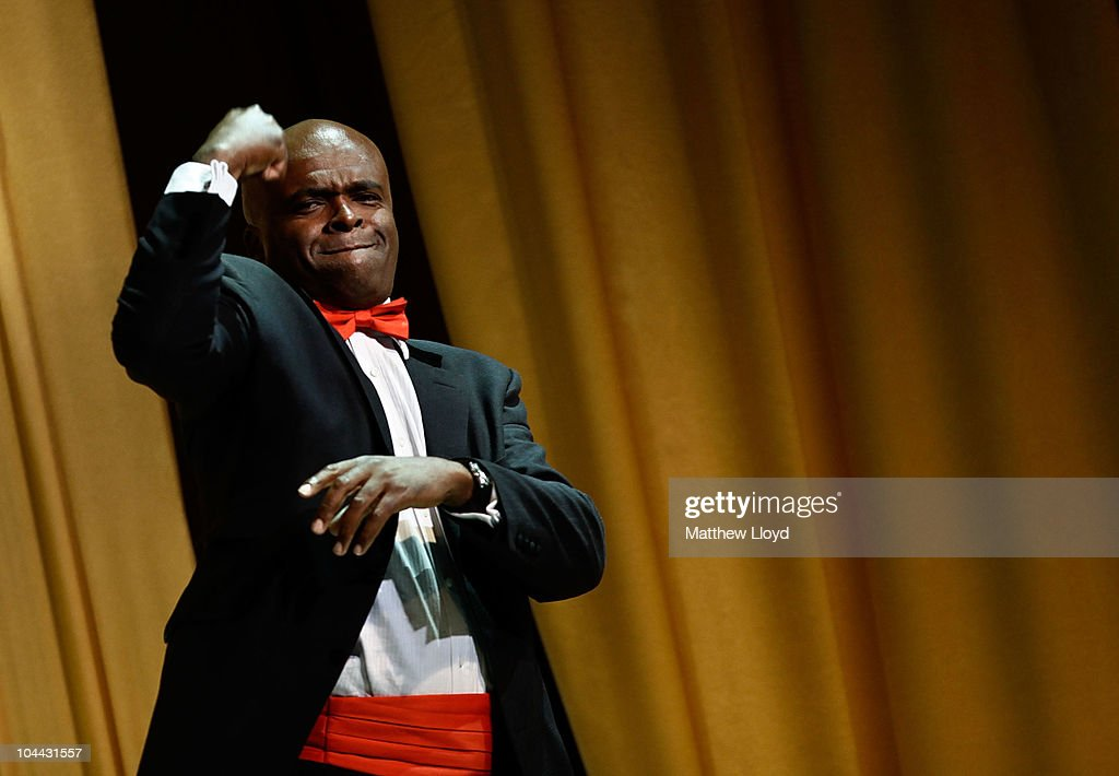 Sir Olympic athletics medallist Kriss Akabusi gestures to guests from the stage at the British Olympic Ball at Grosvener House hotel on September 24, 2010 in London, England. Over 60 Olympic medallists joined an audience of over 1100 to raise funds for Team GB ahead of the London 2012 Olympic Games.