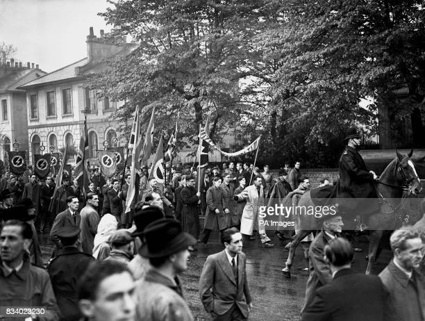 Sir Oswald Mosley supporters holding an open air May Day meeting Police mingled with the crowds who formed to hear speakers surrounded by Union...