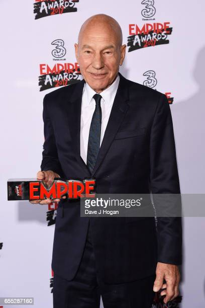 Sir Patrick Stewart poses with the award for Empire Legend in the winners room at the THREE Empire awards at The Roundhouse on March 19 2017 in...