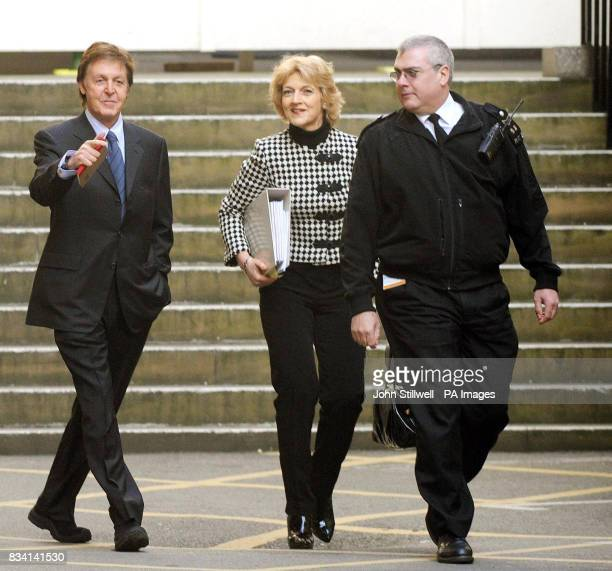 Sir Paul McCartney and Fiona Shackleton arrive at the High Court today to continue thrashing out a divorce settlement with Heather Mills