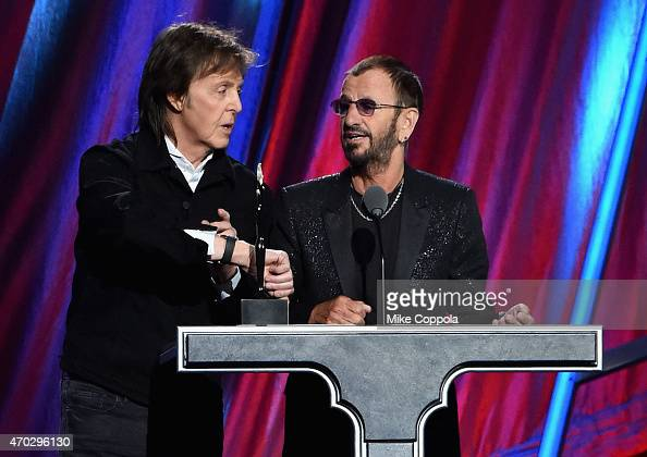 Sir Paul McCartney and inductee Ring Starr speak onstage during the 30th Annual Rock And Roll Hall Of Fame Induction Ceremony at Public Hall on April...