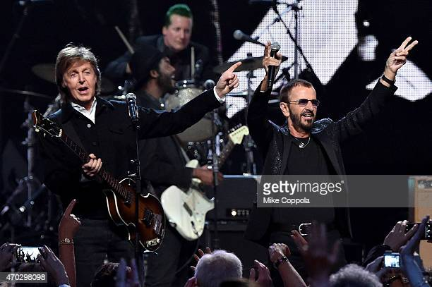 Sir Paul McCartney and inductee Ringo Starr perform onstage during the 30th Annual Rock And Roll Hall Of Fame Induction Ceremony at Public Hall on...