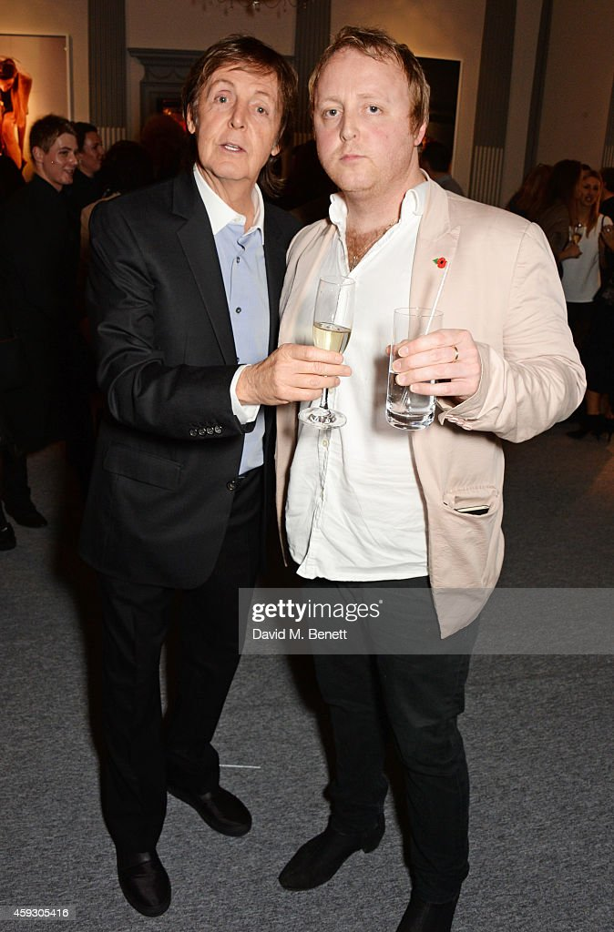 Sir Paul McCartney (L) and James McCartney attend the book launch and private view of 'Mary McCartney: Monochrome And Colour' curated by De Pury De Pury on November 20, 2014 in London, England.