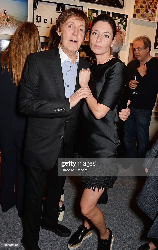 Sir Paul McCartney (L) and Mary McCartney attend the book launch and private view of 'Mary McCartney: Monochrome And Colour' curated by De Pury De Pury on November 20, 2014 in London, England.