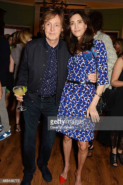 Sir Paul McCartney and Nancy Shevell attend The London 2014 Stella McCartney Green Carpet Collection during London Fashion Week at The Royal British...