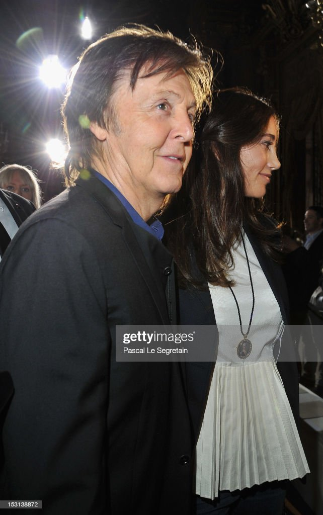 Sir <a gi-track='captionPersonalityLinkClicked' href=/galleries/search?phrase=Paul+McCartney&family=editorial&specificpeople=92298 ng-click='$event.stopPropagation()'>Paul McCartney</a> and <a gi-track='captionPersonalityLinkClicked' href=/galleries/search?phrase=Nancy+Shevell&family=editorial&specificpeople=5085391 ng-click='$event.stopPropagation()'>Nancy Shevell</a> (R) attend the Stella McCartney Spring / Summer 2013 show as part of Paris Fashion Week on October 1, 2012 in Paris, France.