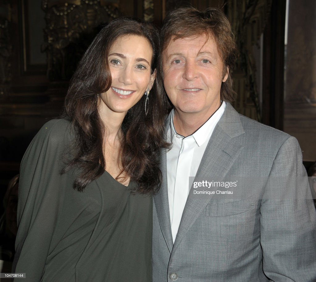 Sir Paul McCartney and Nancy Shevell attend the Stella McCartney Ready to Wear Spring/Summer 2011 show during Paris Fashion Week on October 4 2010 in...