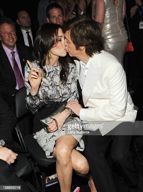Sir Paul McCartney and Nancy Shevell kiss in the audience at the 54th Annual GRAMMY Awards held at Staples Center on February 12 2012 in Los Angeles...