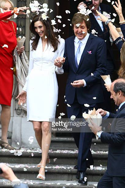 Sir Paul McCartney and Nancy Shevell seen leaving Marylebone Registry Office after their wedding on October 9 2011 in London England