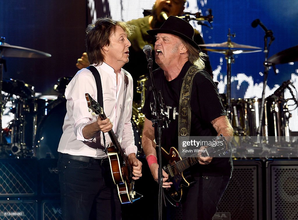 Sir Paul McCartney (L) and Neil Young perform onstage during Desert Trip at the Empire Polo Field on October 8, 2016 in Indio, California.