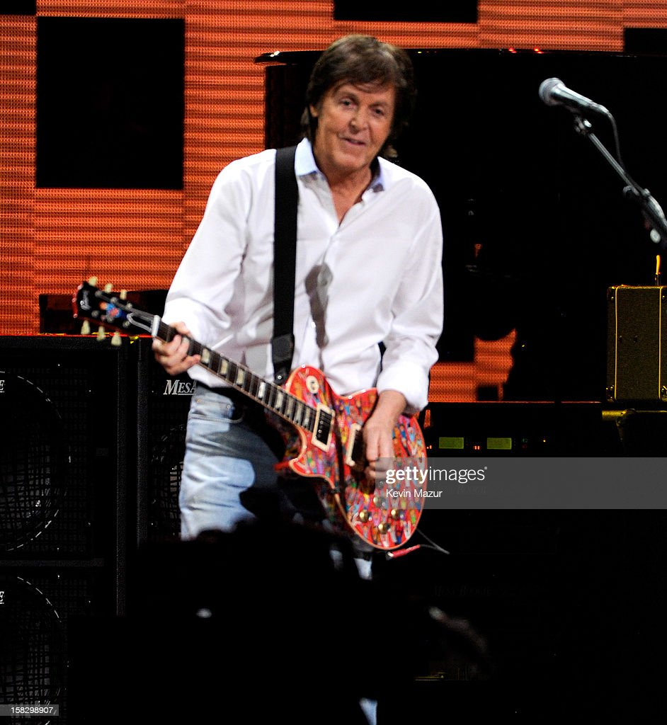 Sir <a gi-track='captionPersonalityLinkClicked' href=/galleries/search?phrase=Paul+McCartney&family=editorial&specificpeople=92298 ng-click='$event.stopPropagation()'>Paul McCartney</a> performs at '12-12-12' a concert benefiting The Robin Hood Relief Fund to aid the victims of Hurricane Sandy presented by Clear Channel Media & Entertainment, The Madison Square Garden Company and The Weinstein Company at Madison Square Garden on December 12, 2012 in New York City.