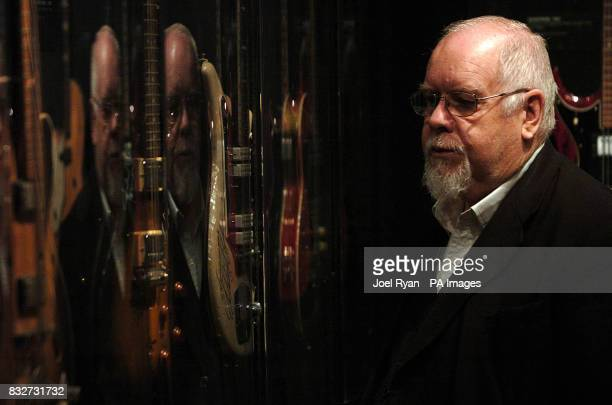 Sir Peter Blake looks at a 1959 Eddie Cochran guitar as the Worlds most valuable electric guitars arrive in a security van at Harrods central London